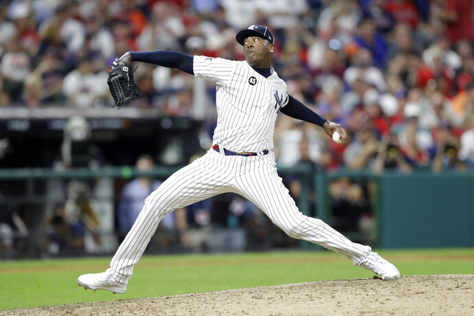 American League pitcher Aroldis Chapman, of the New York Yankees, throws during the ninth inning of the MLB baseball All-Star Game against the National League, Tuesday, July 9, 2019, in Cleveland. (AP Photo/Tony Dejak)