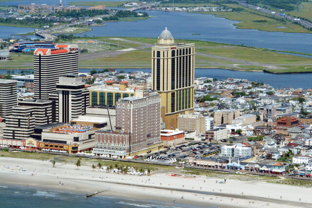 This July 11, 2014 aerial photo shows the Tropicana casino, center, in Atlantic City N.J. The Tropicana announced Wednesday, Sept. 16, 2020, the appointment of Jacqueline Grace senior vice president and general manager, making her the fourth women currently in charge of an Atlantic City casino and the second Black woman. (AP Photo/Wayne Parry)