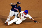 Philadelphia Phillies' J.T. Realmuto, right, is tagged out by Boston Red Sox third baseman Rafael Devers after trying to advance to third on a wild pitch during the fourth inning of the second baseball game in a doubleheader, Tuesday, Sept. 8, 2020, in Philadelphia. (AP Photo/Matt Slocum)