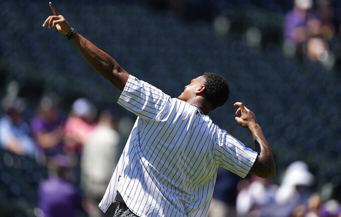 Denver Broncos rookie defenisve back Pat Surtain II reacts after throwing out the ceremonial first pitch before the Colorado Rockies host the Arizona Diamondbacks in a baseball game Sunday, Aug. 22, 2021, in Denver. (AP Photo/David Zalubowski)