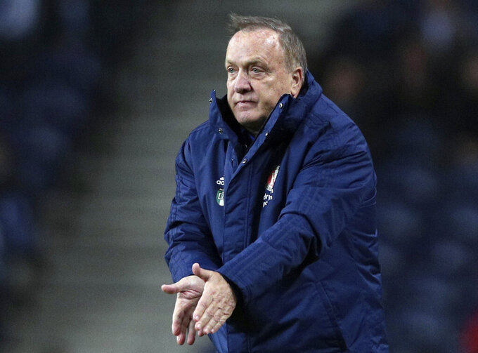 FILE - In this Thursday, Dec. 12, 2019 file photo, Feyenoord's head coach Dick Advocaat gestures during their Europa League group G soccer match against FC Porto at the Dragao stadium in Porto, Portugal. Veteran coach Dick Advocaat has extended his contract with Feyenoord by a year to keep him in charge of the Rotterdam club through next season, it was announced Tuesday, April 21, 2020. Feyenoord hired Advocaat in late October to succeed Jaap Stam, who resigned after less than half a season in charge and with the team struggling at 12th in the top flight Eredivisie.  (AP Photo/Miguel Angelo Pereira, file)