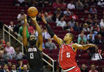 Houston Rockets' James Harden (13) shoots as Portland Trail Blazers' Rodney Hood (5) defends during the first half of an NBA basketball game Monday, Nov. 18, 2019, in Houston. (AP Photo/David J. Phillip)