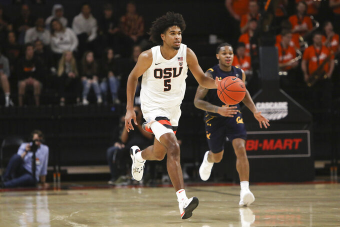 FILE - In this March 7, 2020, file photo, Oregon State's Ethan Thompson (5) drives upcourt during the second half of an NCAA college basketball game against California in Corvallis, Ore. Wayne Tinkle is still coach at Oregon State but his son Trey, the school's all-time leading scorer, is awaiting the NBA draft. Shot-blocking specialist Kylor Kelley has moved on too. But Ethan Thompson has returned for his senior season. (AP Photo/Amanda Loman, File)