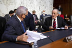 Sen. Jim Risch, R-Idaho, right, speaks to Sen. Bob Menendez, D-N.J., left, before a Senate Foreign Relations Committee meeting on Capitol Hill in Washington, Wednesday, Aug. 4, 2021. (AP Photo/Amanda Andrade-Rhoades)