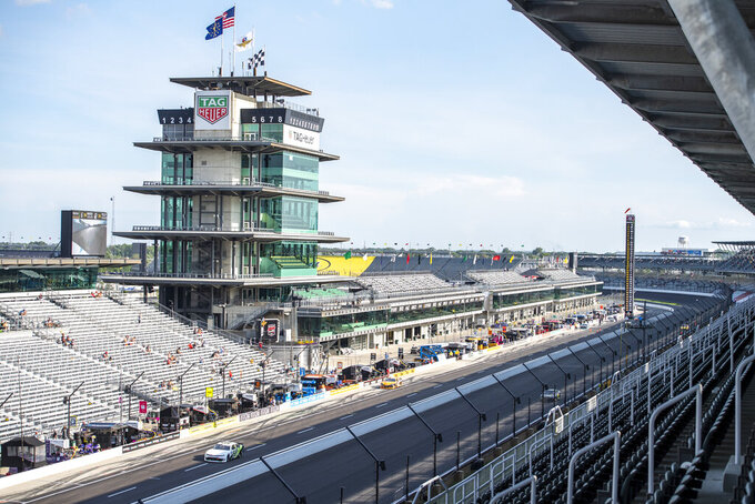 Drivers come and go through the pits during practice for the NASCAR Xfinity Series auto race at Indianapolis Motor Speedway, Friday, Aug. 13, 2021, in Indianapolis. (AP Photo/Doug McSchooler)