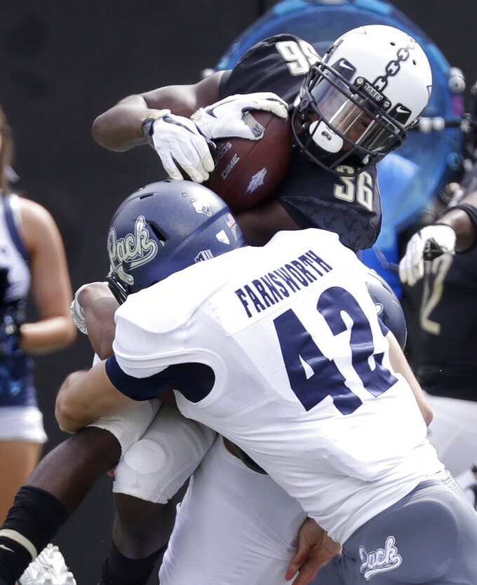 Vanderbilt kick returner Trey Ellis (36) is stopped by Nevada long snapper Wes Farnsworth (42) as Ellis returns a punt in the first half of an NCAA college football game Saturday, Sept. 8, 2018, in Nashville, Tenn. (AP Photo/Mark Humphrey)