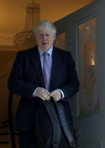 British Conservative party leadership and prime minister contender Boris Johnson leaves his home in south London, Thursday June 20, 2019. The race to become Britain's next prime minister is down to the final four on Wednesday, as Boris Johnson stretched his lead among Conservative lawmakers and upstart Rory Stewart was eliminated from the contest. (AP Photo/Matt Dunham)