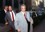 FILE - In this Feb. 9, 1990 file photo, John Gotti, right, arrives at court in New York. The Gambino family was once among the most powerful criminal organizations in the U.S., but federal prosecutions in the 1980s and 1990s sent Gotti and other top leaders to prison, diminishing its reach. The last Mafia boss to be shot to death in New York City was Gambino don Paul Castellano, assassinated outside a Manhattan steakhouse in 1985 at the direction of Gotti, who then took over the organization. On Wednesday, March 13, 2019, Francesco