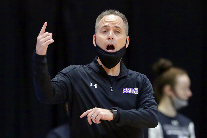 Stephen F. Austin head coach Mark Kellogg during the first half of an NCAA college basketball game against Sam Houston State for the Southland Conference women's tournament championship Sunday, March 14, 2021, in Katy, Texas. (AP Photo/Michael Wyke)