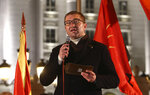 Hristijan Mickoski, leader of the opposition VMRO-DPMNE party talks to the supporters during a protest in front of the government building in Skopje, North Macedonia, late Thursday, Nov. 26, 2020. Main conservative opposition leader Mickoski has called late on Thursday leftist Prime minister Zoran Zaev to resign after his controversial interview given to one Bulgarian media in which he mitigated Bulgaria's occupation role in then Macedonia during the World War II. (AP Photo/Boris Grdanoski)