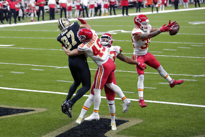 Kansas City Chiefs strong safety Tyrann Mathieu (32), free safety Daniel Sorensen (49) and safety Armani Watts break up a pass in the end zone intended for New Orleans Saints tight end Jared Cook (87) in the second half of an NFL football game in New Orleans, Sunday, Dec. 20, 2020. (AP Photo/Brett Duke)