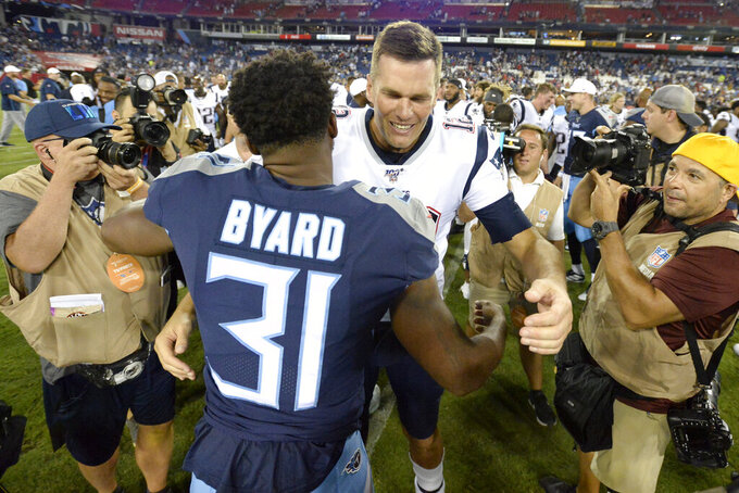 New England Patriots quarterback Tom Brady greets Tennessee Titans free safety Kevin Byard (31) after a preseason NFL football game Saturday, Aug. 17, 2019, in Nashville, Tenn. The Patriots won 22-17. (AP Photo/Mark Zaleski)