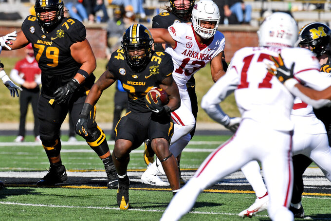 Missouri running back Larry Rountree III (34) runs with the ball during the first half of an NCAA college football game against Arkansas Saturday, Dec. 5, 2020, in Columbia, Mo. (AP Photo/L.G. Patterson)