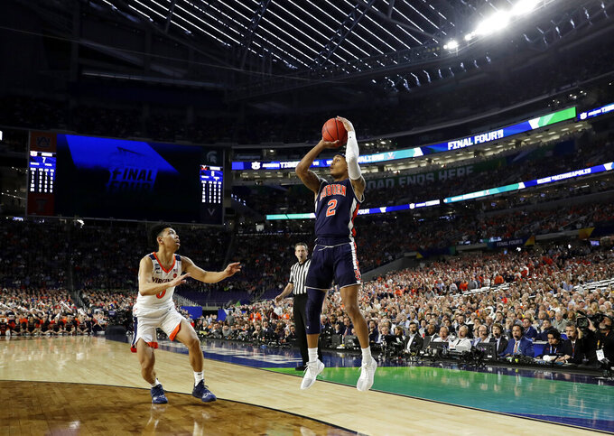 Auburn guard Bryce Brown shoots over Virginia guard Kihei Clark, left, during the first half in the semifinals of the Final Four NCAA college basketball tournament, Saturday, April 6, 2019, in Minneapolis. (AP Photo/David J. Phillip)
