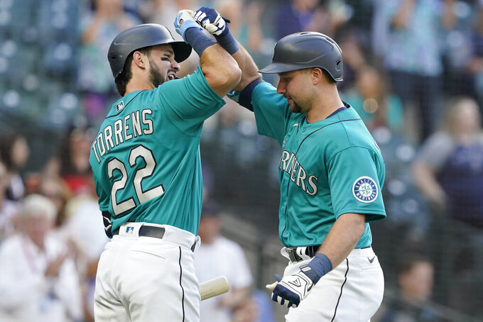 Seattle Mariners' Cal Raleigh, right, is greed by Luis Torrens (22) after Raleigh hit a two-run home run against the Oakland Athletics during the second inning of a baseball game, Friday, July 23, 2021, in Seattle. Torrens hit a solo home run in his ensuing at-bat. (AP Photo/Ted S. Warren)