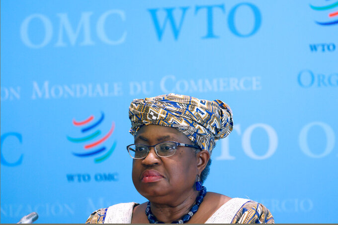 "FILE - In this April 1, 2021 file picture, World Trade Organisation (WTO) Director-General Ngozi Okonjo-Iweala attends a news conference at WTO headquarters in Geneva, Switzerland. The head of the World Trade Organization said Friday, May 7, 2021, the U.S. administration's call to remove patent protections on COVID-19 vaccines will give an impetus to negotiations to resolve access inequity but such a waiver might not be the ""critical issue"" against the pandemic. (Denis Balibouse/Pool via AP)"