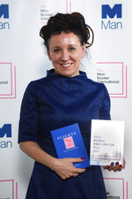 FILE - In this file photo dated May 22, 2018, Polish author Olga Tokarczuk after winning the Man Booker International prize 2018, for her book Flights.  Polish novelist Olga Tokarczuk was named Thursday Oct. 10, 2019, winner of the 2018 Nobel Prize for literature. (Matt Crossick/PA FILE via AP)