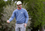 Jon Rahm, of Spain, reacts to his putt on the second hole during the final round of The Players Championship golf tournament Sunday, March 17, 2019, in Ponte Vedra Beach, Fla. (AP Photo/Lynne Sladky)