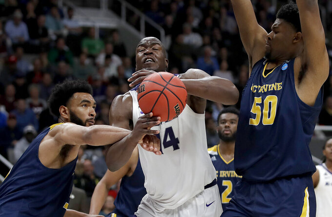 Kansas State forward Makol Mawien, center, loses the ball between UC Irvine forward Jonathan Galloway, left, and forward Elston Jones (50) during the second half of a first round men's college basketball game in the NCAA Tournament Friday, March 22, 2019, in San Jose, Calif. (AP Photo/Ben Margot)