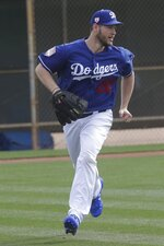 Los Angeles Dodgers' Clayton Kershaw runs a drill during a spring training baseball workout Wednesday, Feb. 13, 2019, in Glendale, Ariz. (AP Photo/Morry Gash)