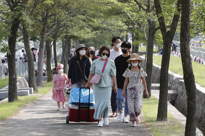 People wearing face masks to help protect against the spread of the new coronavirus visit to pay their respects on Memorial Day at the national cemetery in Seoul, South Korea, Saturday, June 6, 2020. (AP Photo/Ahn Young-joon)