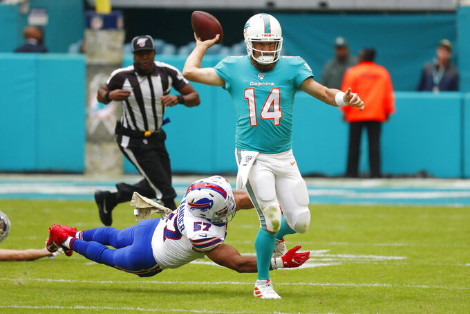 Buffalo Bills outside linebacker Lorenzo Alexander (57) attempts to tackle Miami Dolphins quarterback Ryan Fitzpatrick (14), during the first half at an NFL football game, Sunday, Nov. 17, 2019, in Miami Gardens, Fla. (AP Photo/Wilfredo Lee)