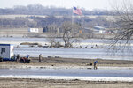 Farmers work on land isolated by the swollen waters of the North Fork of the Elkhorn River, in Norfolk, Neb., Friday, March 15, 2019. Heavy rain falling atop deeply frozen ground has prompted evacuations along swollen rivers in Wisconsin, Nebraska and other Midwestern states. Thousands of people have been urged to evacuate along eastern Nebraska rivers as a massive late-winter storm has pushed streams and rivers out of their banks throughout the Midwest. (AP Photo/Nati Harnik)
