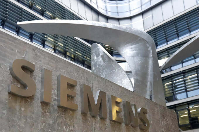 FILE - This Thursday, Nov. 9, 2017 file photo shows the logo of German industrial conglomerate Siemens in front of their headquarters in Munich, Germany. Siemens ignored some of its own red flags for foreign bribery in the aftermath of a major corruption scandal in 2008, according to reports released in 2021 by an independent monitor and other confidential documents. (AP Photo/Matthias Schrader, File)