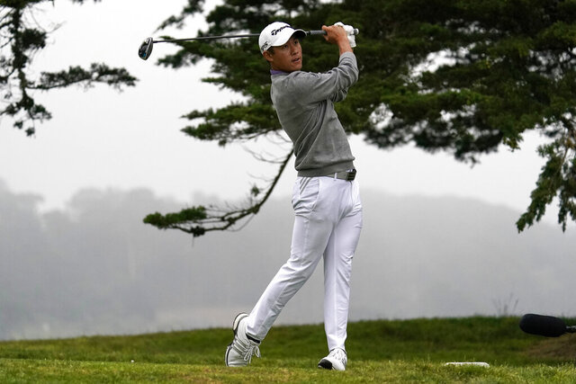 FILE - In this Sunday, Aug. 9, 2020, file photo, Collin Morikawa watches his tee shot on the 16th hole during the final round of the PGA Championship golf tournament at TPC Harding Park in San Francisco. His drive to 7 feet for eagle was the defining moment of his first major title. (AP Photo/Jeff Chiu, File)