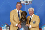 Jimmy Johnson, right, a member of the Pro Football Hall of Fame Centennial Class, poses with his presenter, Troy Aikman, during the induction ceremony at the Pro Football Hall of Fame, Saturday, Aug. 7, 2021, in Canton, Ohio. (AP Photo/Ron Schwane, Pool)