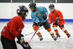 In this Feb. 21, 2019 photo Malakye Johnson takes part in a Snider Hockey practice at the Scanlon Ice Rink in Philadelphia. (AP Photo/Matt Rourke)