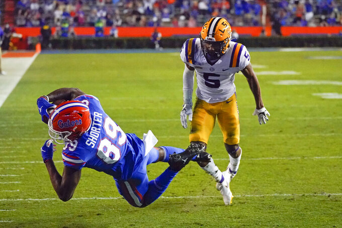 Florida wide receiver Justin Shorter (89) makes a reception in front of LSU cornerback Jay Ward (5) during the first half of an NCAA college football game Saturday, Dec. 12, 2020, in Gainesville, Fla. (AP Photo/John Raoux)