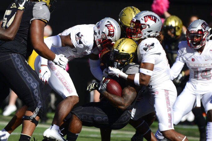 Vanderbilt running back Ke'Shawn Vaughn scores a touchdown against UNLV in the first half of an NCAA college football game Saturday, Oct. 12, 2019, in Nashville, Tenn. (AP Photo/Mike Strasinger)