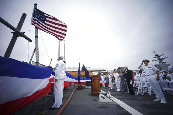 Navy Secretary Richard Spencer and other Navy officials attend the morning colors during a rededication ceremony for the USS John S. McCain at the U.S. Naval base in Yokosuka, southwest of Tokyo, Thursday, July 12, 2018. Spencer dedicated one of two destroyers involved in fatal accidents in the Pacific last year to Sen. John McCain.  (AP Photo/Eugene Hoshiko)