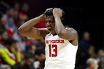 Rutgers forward Shaq Carter reacts after teammate Eugene Omoruyi suffered an injury during the first half of an NCAA college basketball game against Ohio State, Wednesday, Jan. 9, 2019, in Piscataway, N.J. (AP Photo/Julio Cortez)