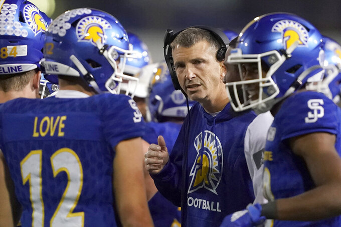 San Jose State head coach Brent Brennan, center, talks with his players during a time out against Boise State in the second half of an NCAA college football game, in San Jose, Calif., Saturday, Nov. 2, 2019. Boise State won 52-42. (AP Photo/Tony Avelar)