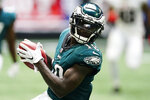 Philadelphia Eagles wide receiver Jalen Reagor (18) makes the catch against the Atlanta Falcons during the second half of an NFL football game, Sunday, Sept. 12, 2021, in Atlanta. (AP Photo/John Bazemore)
