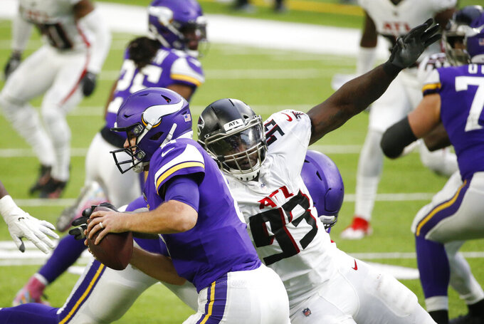 Atlanta Falcons defensive end Allen Bailey (93) sacks Minnesota Vikings quarterback Kirk Cousins during the second half of an NFL football game, Sunday, Oct. 18, 2020, in Minneapolis. (AP Photo/Bruce Kluckhohn)