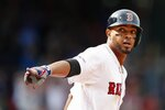 Boston Red Sox's Xander Bogaerts looks back at the dugout as he rounds first base on his three-run home run during the eighth inning of a baseball game against the Baltimore Orioles in Boston, Sunday, April 14, 2019. (AP Photo/Michael Dwyer)