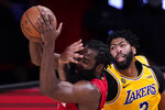 Los Angeles Lakers' Anthony Davis (3) defends against Houston Rockets' James Harden during the second half of an NBA conference semifinal playoff basketball game Thursday, Sept. 10, 2020, in Lake Buena Vista, Fla. The Lakers won 110-100. (AP Photo/Mark J. Terrill)