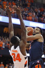 Virginia's Braxton Key, right, shoots over Syracuse's Bourama Sidibe, left, during the first half of an NCAA college basketball game in Syracuse, N.Y., Wednesday, Nov. 6, 2019. (AP Photo/Nick Lisi)