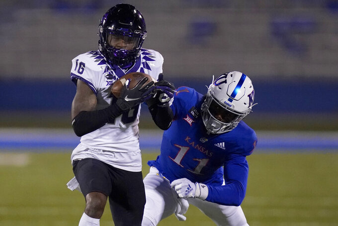 TCU cornerback C.J. Ceasar II (16) intercepts a pass intended for Kansas wide receiver Ezra Naylor II (11) during the second half of an NCAA college football game in Lawrence, Kan., Saturday, Nov. 28, 2020. Ceasar returned the interception for a touchdown. (AP Photo/Orlin Wagner)