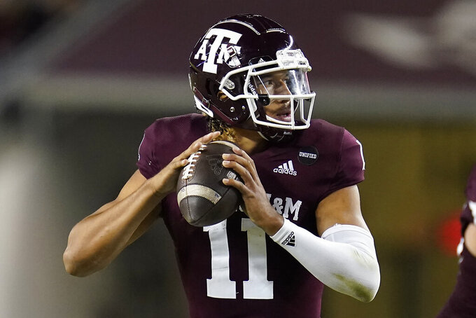Texas A&M quarterback Kellen Mond (11) looks downfield to pass against Arkansas during the second half of an NCAA college football game, Saturday, Oct. 31, 2020, in College Station, Texas. (AP Photo/Sam Craft)