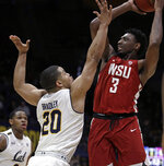 Washington State's Robert Franks, right, shoots against California's Matt Bradley (20) in the first half of an NCAA college basketball game Saturday, March 2, 2019, in Berkeley, Calif. (AP Photo/Ben Margot)