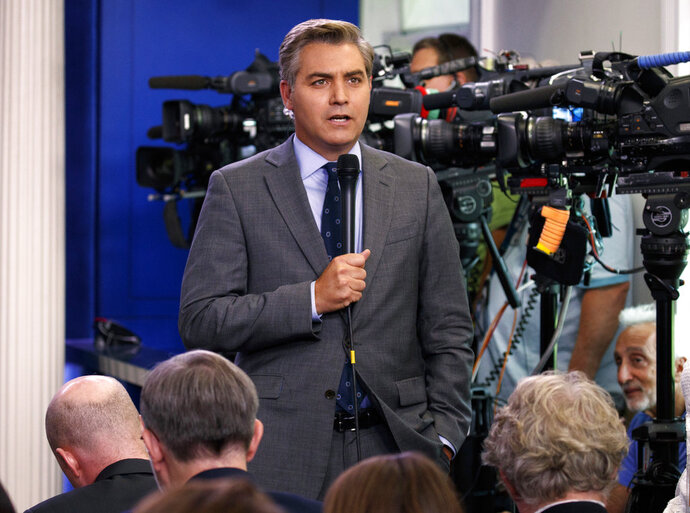 FILE - In this Aug. 2, 2018 file photo, CNN correspondent Jim Acosta does a stand up before the daily press briefing at the White House in Washington. The White House on Wednesday suspended the press pass of CNN correspondent Jim Acosta after he and President Donald Trump had a heated confrontation during a news conference. (AP Photo/Evan Vucci, File)