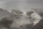 A motorbike rider races during stage two of the Dakar Rally, between Al Wajh and Neom, Saudi Arabia, Monday, Jan. 6, 2020. (AP Photo/Bernat Armangue)