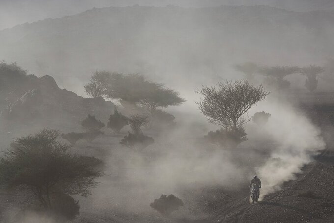 A motorbike rider races during stage two of the Dakar Rally, between Al Wajh and Neom, Saudi Arabia, Monday, Jan. 6, 2020. (AP Photo/Bernat Armangue)