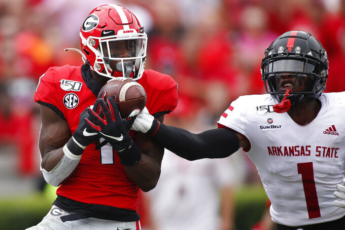 Arkansas State corner back Jerry Jacobs (1) breaks up a pass from Georgia quarterback Jake Fromm (11) intended for Georgia wide receiver George Pickens (1) in the first half of a NCAA football game between Georgia and Arkansas State in Athens, Ga., on Saturday, Sept. 14, 2019. (Joshua L. Jones/Athens Banner-Herald via AP)