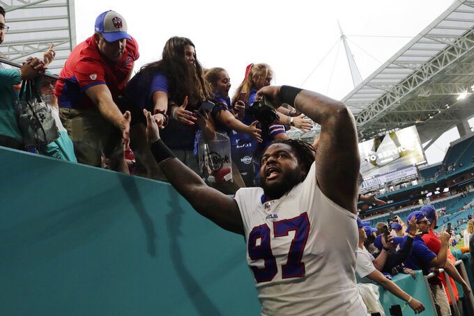 Buffalo Bills defensive tackle Jordan Phillips (97) cheers as he leaves the field, at the end of an NFL football game against the Miami Dolphins, Sunday, Nov. 17, 2019, in Miami Gardens, Fla. The Bills defeated the Dolphins 37-20. (AP Photo/Lynne Sladky)