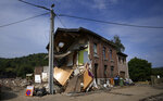 The side of a house is collapsed in the village of Trooz, Belgium, Tuesday, July 27, 2021. Three people have been left dead in the small village and nearly half of it's residents have sustained damage to their homes (AP Photo/Virginia Mayo)